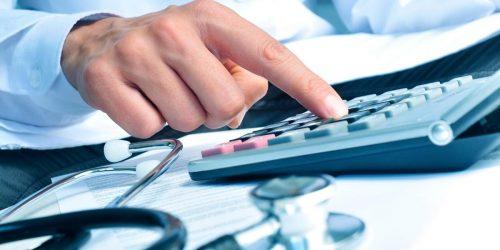 A provider calculating healthcare revenue declines due to COVID-19